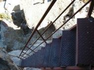 Looking down a crazy flight of stairs at Ortahisar Castle, they were on the outside of the rock