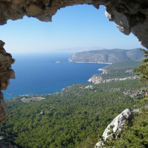 View from a hole in the stonework in Monolithos down to the coast below